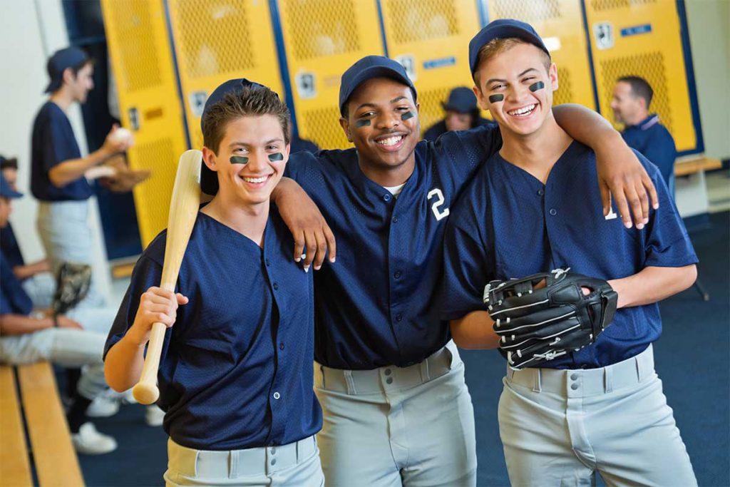 High school baseball players in locker room